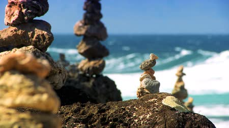 counselling : Natural rock stones balanced on shoreline with ocean backdrop