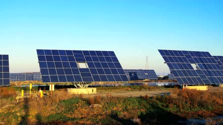 e : Farms of photovoltaic solar panels producing clean sustainable energy