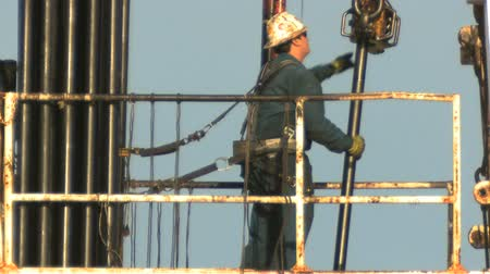 gas : Oil rig crew manual worker on platform in safety harness