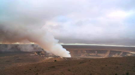 volcanology : Hot steam erupting from a volcanic crater in barren landscape