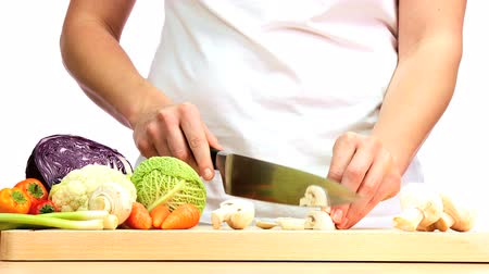 chef cooking : Healthy fresh vegetables being chopped to provide ingredients for modern lifestyle food