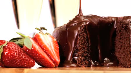 biszkopt : Sticky chocolate cake being covered in sauce while served with fresh strawberries & sparkling white wine