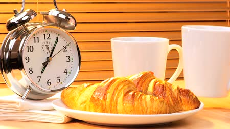 coffee time : Clock hands symbolizing the need to make time for breakfast in a busy modern lifestyle Stock Footage