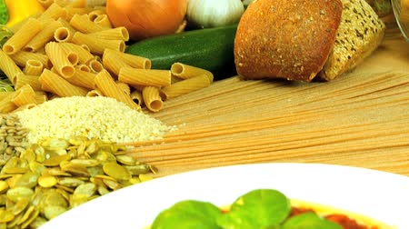 massa : Traditional italian spaghetti bolognese  surrounded by healthy option vegetables & pulses