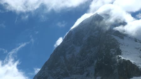 peak : Slow moving clouds over rugged summit of Eiger, Swiss Alps Stock Footage