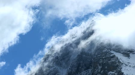 doruk : Time-lapse clouds over the rugged face of the Eiger, Swiss Alps Stok Video