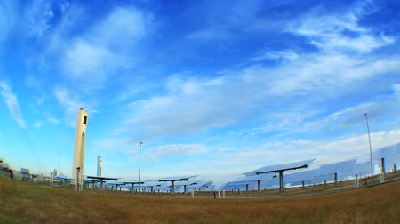 e : Fish-eye time-lapse clouds over environmentally clean solar energy plant