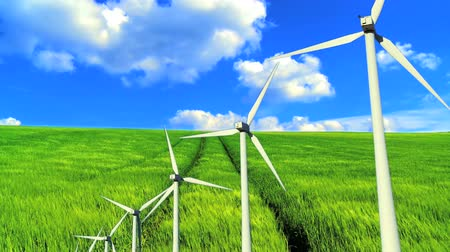 renovável : Blue sky with time-lapse clouds over green grass fields and clean wind turbine energy production