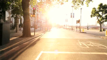 morning : Point-of view driving through city streets with early morning commuters Stock Footage