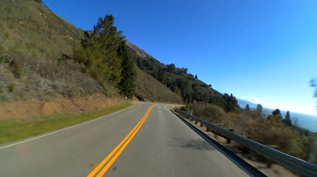 enrolamento : Point-of-view driving the Pacific Coast highway Stock Footage