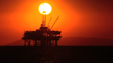 rigs : Oil platform at sea at sunset Stock Footage