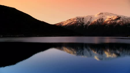 enriching : Time-lapse sunrise over a glacial fjord