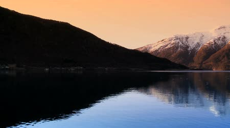 enriching : Sunrise over the crystal waters of a glacial fjord