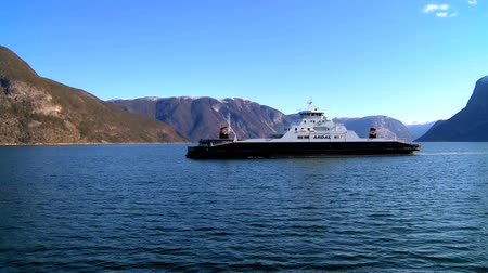 enriching : Passenger ferry on the crystal waters of a glacial fjord