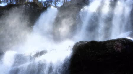 tiered : Spray from cascading waters of a powerful waterfall Stock Footage