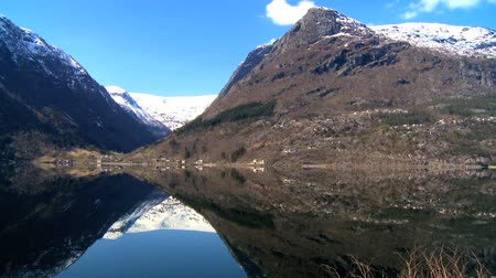 enriching : Mirror image of mountains in crystal clear water of nordic fjord