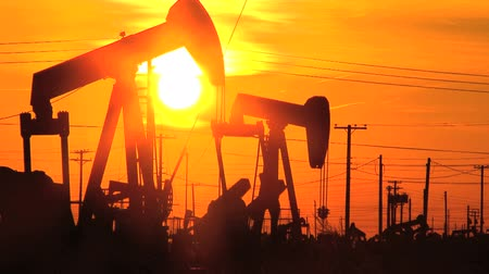 rigs : Collection of commercial scenes of fossil fuel production at sunset