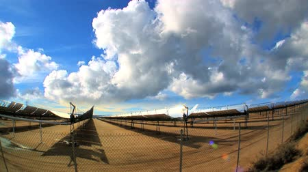 e : Time-lapse clouds over cluster of solar energy producing panels