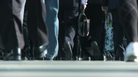 üzleti öltöny : Close-up legs & feet of busy city commuters in slow motion