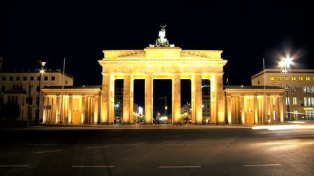 gates : People visiting the Brandenburg Gate in Berlin when illuminated at night in time-lapse