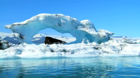 olvad : Glacial iceberg slowly melting into the lake through global warming 60 FPS