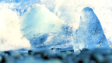 climate : Melting glacial ice from climate change washed up on an arctic beach 60 FPS Stock Footage