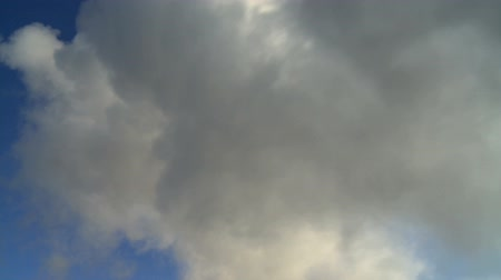 evaporate : Hot steam clouds from geothermal power plant against blue sky (real time) Stock Footage