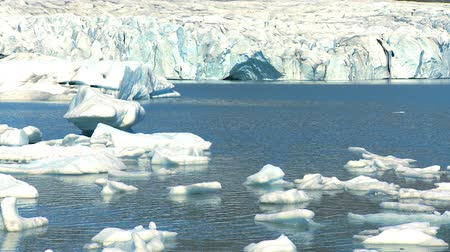 manmade : jokulsarlon glacier slowly melting into the lake through global warming