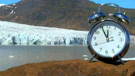 climate : Time-lapse concept shot of  hands on a clock moving swiftly as time to prevent climate change runs out