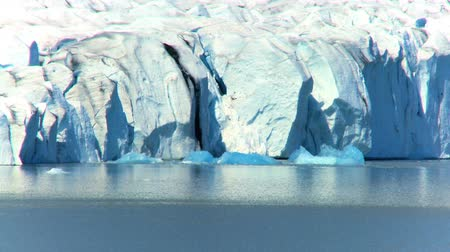 climate : Glacial iceberg slowly melting into the lake through global warming