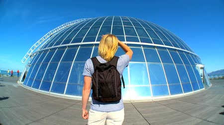 panel buildings : Female visitor at  the dome of solar panels at Pearl Museum, Iceland