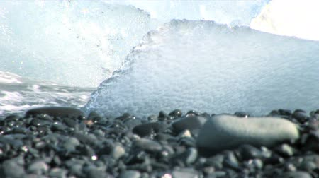 manmade : Melting glacial ice from climate change washed up on an arctic beach Stock Footage