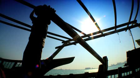 fishermen : Middle-eastern fisherman in silhouette on his traditional wooden dhow Stock Footage
