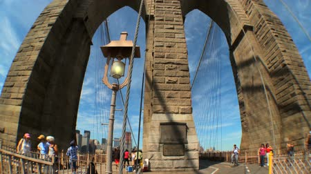 no traffic : Motion-jib with fish-eye view of pedestrians & gothic arches of Brooklyn Bridge, New York City, USA Stock Footage