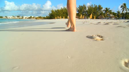 rejtekhely : Young caucasian girl leaving footprints in the white sand of a tropical beach 60 FPS