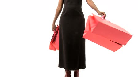 zsák : Attractive african woman with her expensive shopping bags in slow motion
