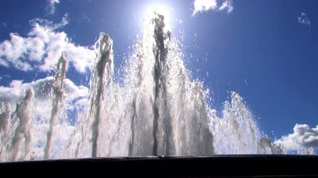 water jet : Fountain jets of crystal clear water with blue sky background Stock Footage