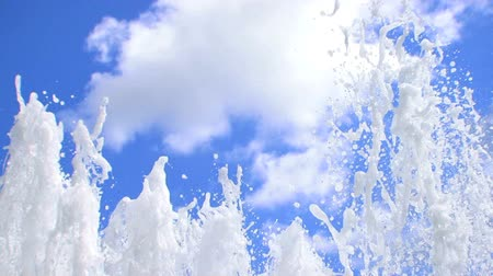 water jet : Jets of crystal clear bubbling water shooting up to a blue sky