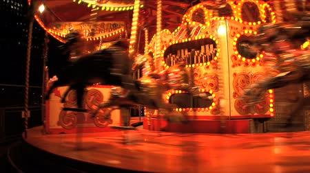 atividades : Fairground carousel at night in London at Christmas Stock Footage