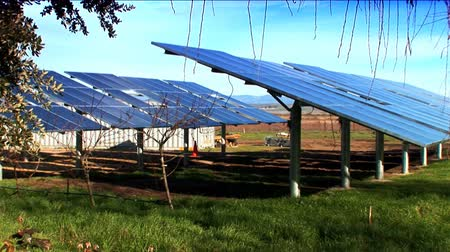 e : Cluster of solar panels producing clean renewable energy