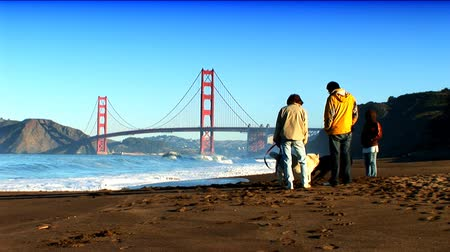 tower bridge : Golden Gate Bridge seen by people enjoying the beach across the bay Stock Footage