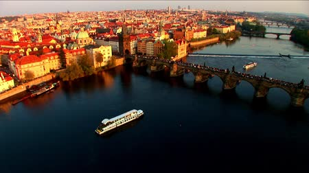 prague bridge : Aerial view of river traffic & city of Prague, Czech Republic Stock Footage