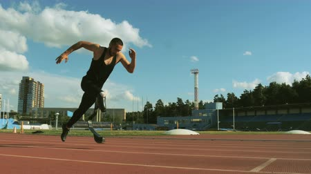 paralympic : start and run athlete disabled at carbon prosthesis on track stadium