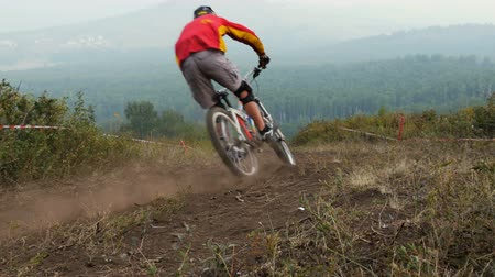 helmets : Extreme mountain bike sport athlete man riding dusty trail