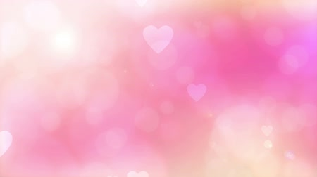 romantic blurred loop animation background with lights and heart.