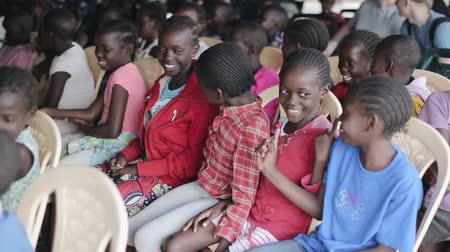 third world : KISUMU,KENYA - MAY 21, 2018: Group of happy african children sitting in school and playing game together. Stock Footage