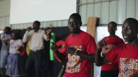 fırsat : KENYA, KISUMU - MAY 20, 2017: African teenagers dancing on a stage together, showing movements. Stok Video