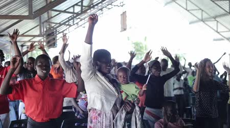 ovation : KENYA, KISUMU - MAY 20, 2017: Big group of african and caucasian people, children dancing together. Stock Footage
