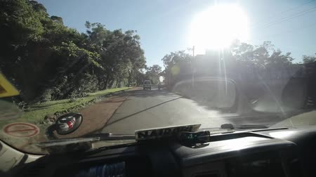 příjezdová cesta : KENYA, KISUMU - MAY 20, 2017: View through the windshield from inside a car. Car is riding through the city in Africa in sunny bright day.