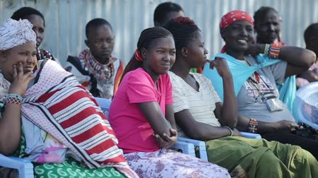 KENYA, KISUMU - MAY 20, 2017: Women from local african tribe maasai sitting on the chairs and looking somewhere. Vídeos
